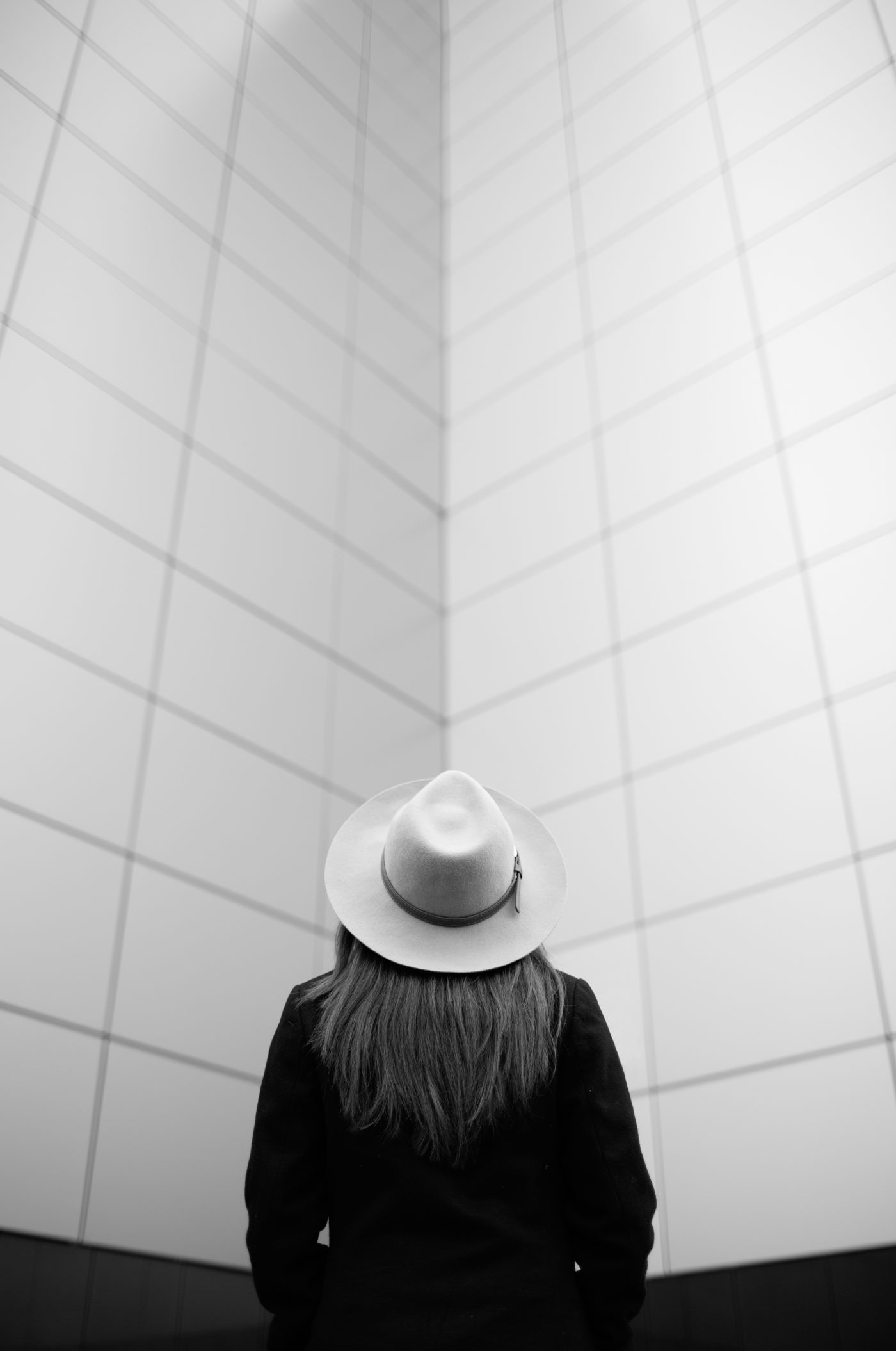 White and black picture of a woman in a hat.