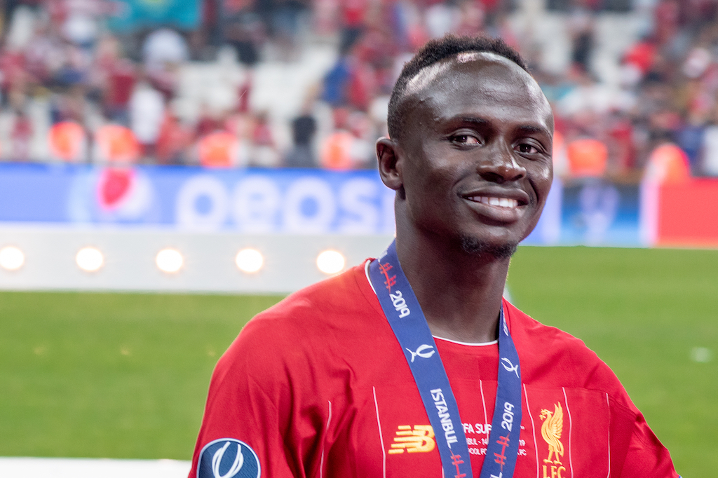 Joy, smiles, cheer of Sadio Mane player of Liverpool FC with happy emotions celebrate UEFA Super Cup trophy victory