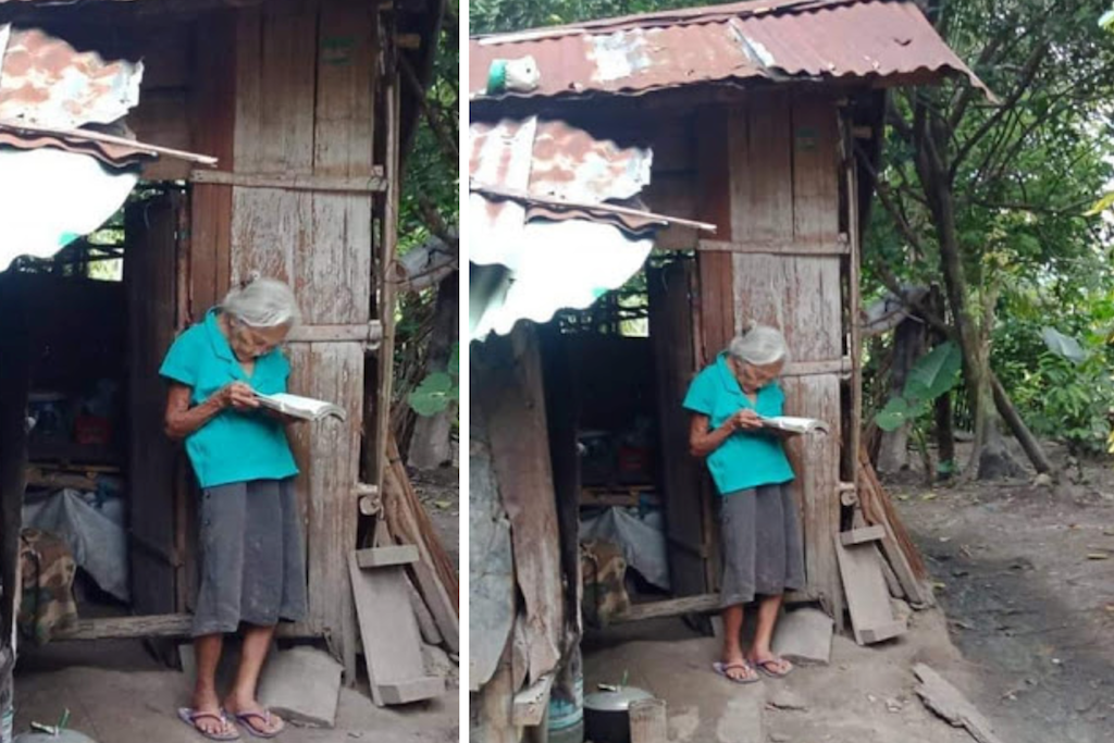 Image of elderly woman outside her Kubo reading the Bible