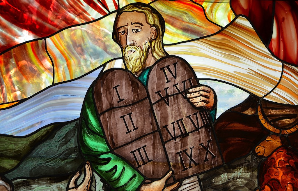 stained glass window depicting Moses with the Ten Commandments
