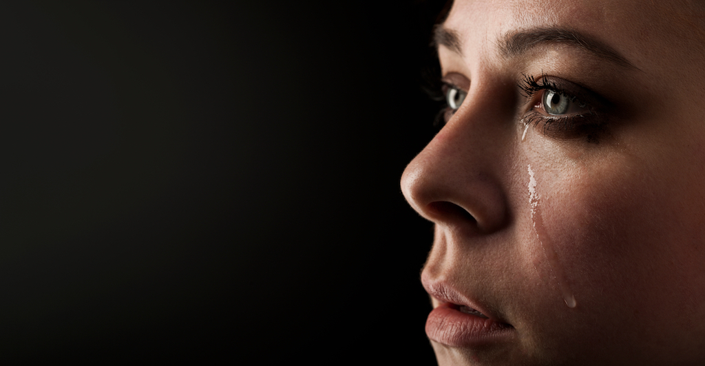 beautiful girl cry with black background