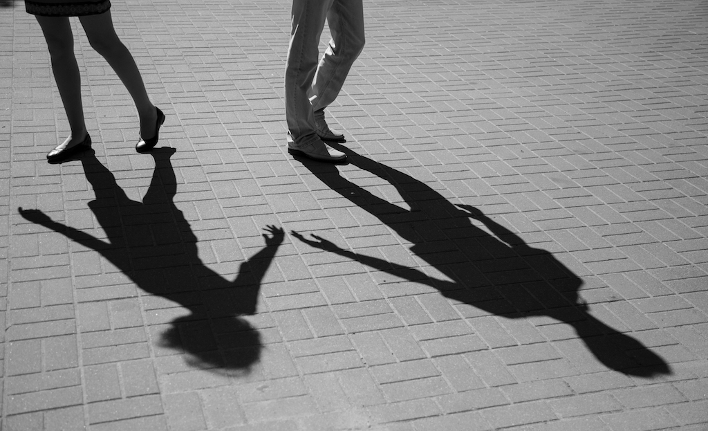 Shadows of two young people