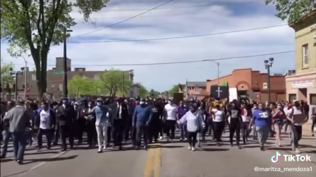 Protesters walking down street in Milwaukee
